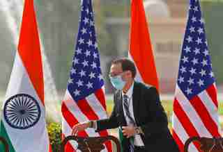 An official adjusts the microphones in front of U.S. and India flags, before a joint news conference  with U.S. Secretary of State Mike Pompeo, India's Foreign Minister Subrahmanyam Jaishankar, India's Defence Minister Rajnath Singh and U.S. Secretary of Defence Mark Esper, in New Delhi, India, October 27, 2020. REUTERS/Adnan Abidi