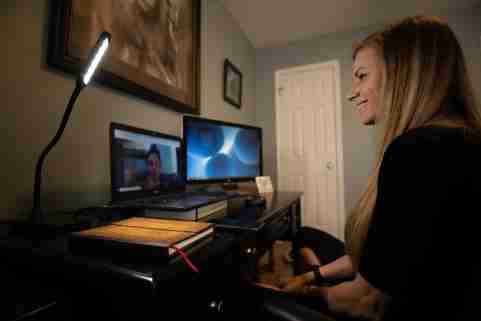 Licensed professional clinical counselor  Aimee Vaughn with Guidestar counseling, working from home as she speaks with a client virtually through Telehealth, April.9, 2020.A Vaughn 1