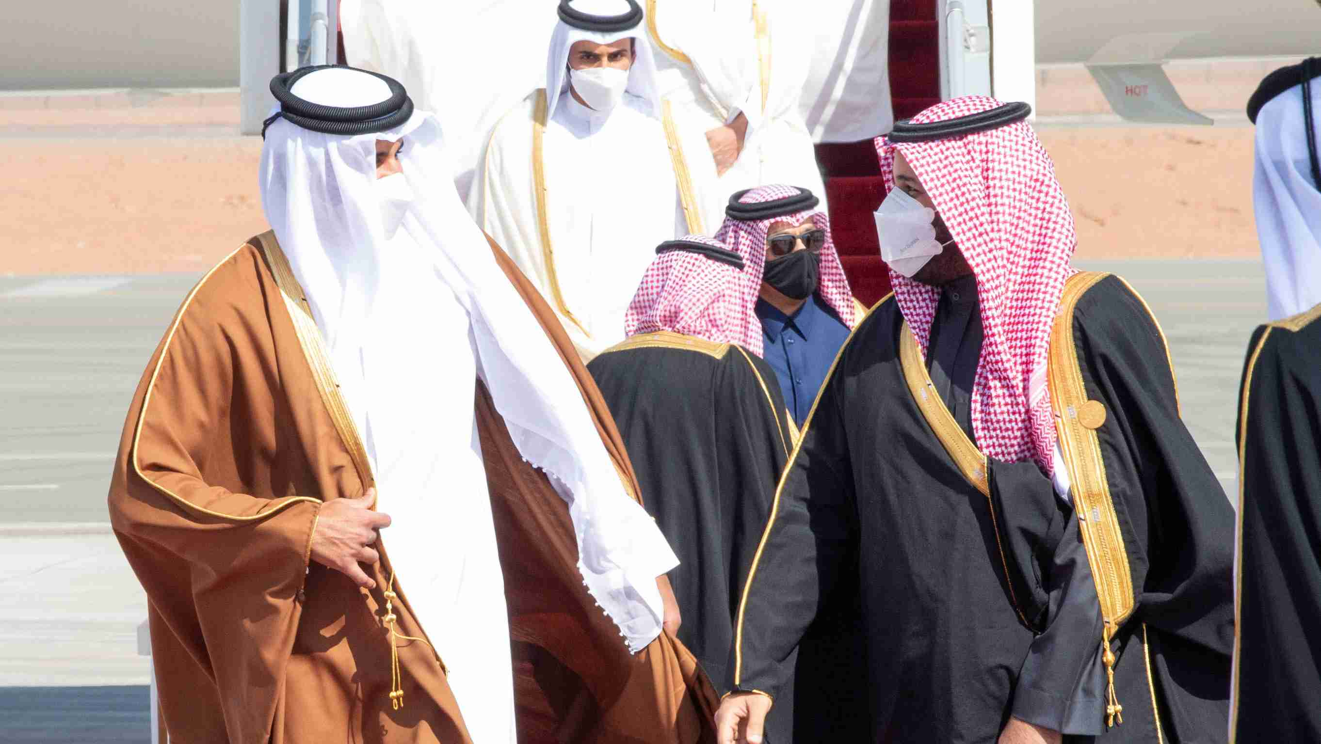 Saudi Arabia's Crown Prince Mohammed bin Salman welcomes Qatar's Emir Sheikh Tamim bin Hamad al-Thani upon his arrival to attend the Gulf Cooperation Council's (GCC) 41st Summit in Al-Ula, Saudi Arabia January 5, 2021. Bandar Algaloud/Courtesy of Saudi Royal Court/Handout via REUTERS ATTENTION EDITORS - THIS PICTURE WAS PROVIDED BY A THIRD PARTY