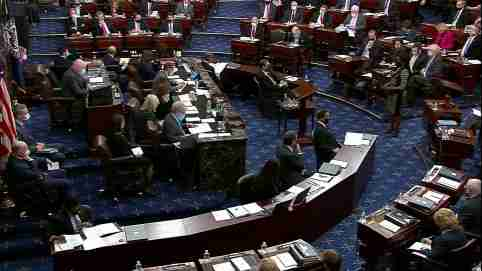 The U.S. Senate votes on the rules to govern the trial as it begins the second impeachment trial of former U.S. President Donald Trump, on charges of inciting the deadly attack on the U.S. Capitol, on the floor of the Senate chamber on Capitol Hill in Washington, U.S., February 9, 2021. U.S. Senate TV/Handout via Reuters