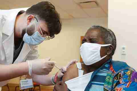 A senior citizen receives an injection of a COVID-19 vaccine.