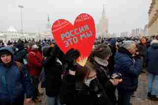 "A protestor holds a heart-shaped sign reading ""I love you, Russia! We are Russia!"" during a rally in support of jailed Russian opposition leader Alexei Navalny in Moscow, Russia January 31, 2021. REUTERS/Maxim Shemetov"