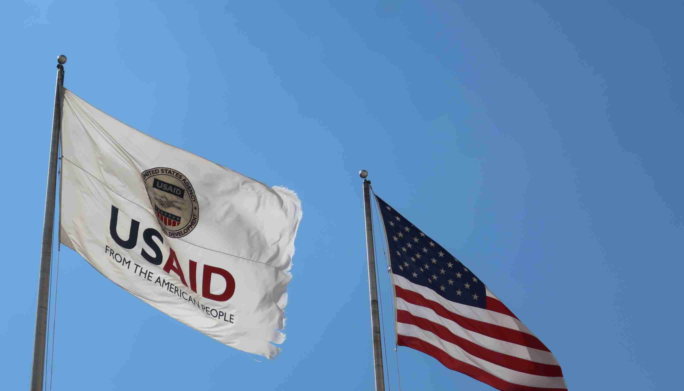 WASHINGTON - AUGUST 2, 2020: USAID Agency for International Development flag with emblem seal outside headquarters building. USAID is the agency that administers foreign aid.