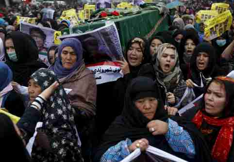 Women chant slogans as they carry one of the coffins for the seven people who were killed by unknown militants, heading towards the presidential palace, during a protest procession in Kabul, Afghanistan, November 11, 2015. Thousands of members of Afghanistan's Hazara ethnic minority demonstrated on Wednesday against government inaction over the killing of seven members of their community by Islamist militants who dumped their partially beheaded bodies. The mainly Shia Hazara have long faced persecution in Afghanistan, with thousands massacred by the Taliban and al Qaeda in the 1990s, but a series of murders and kidnappings this year has stoked a mood of growing despair. REUTERS/Ahmad Masood