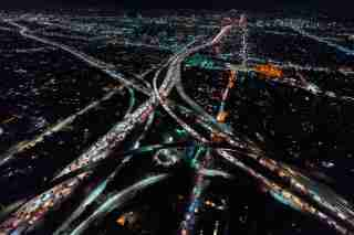 Aerial view of a massive highway in Los Angeles, CA at night