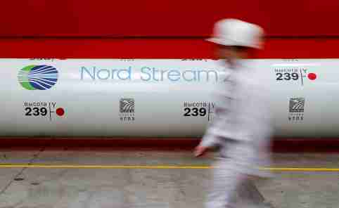 FILE PHOTO: The logo of the Nord Stream 2 gas pipeline project is seen on a pipe at Chelyabinsk pipe rolling plant owned by ChelPipe Group in Chelyabinsk, Russia, February 26, 2020.  REUTERS/Maxim Shemetov/File Photo