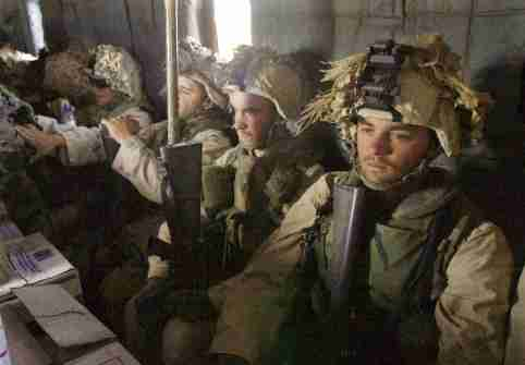 FILE PHOTO: Marine reinforcements fly towards an area somewhere near Kandahar, Afghanistan, December 10, 2001.  Earnie Grafton, The San Diego Union-Tribune/Pool via REUTERS/File Photo