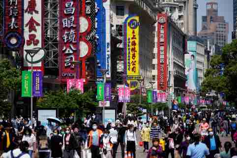 People walk along Nanjing Pedestrian Road, a main shopping area, during the Labour Day holiday, following the outbreak of the coronavirus disease (COVID-19), in Shanghai, China May 5, 2021. REUTERS/Aly Song