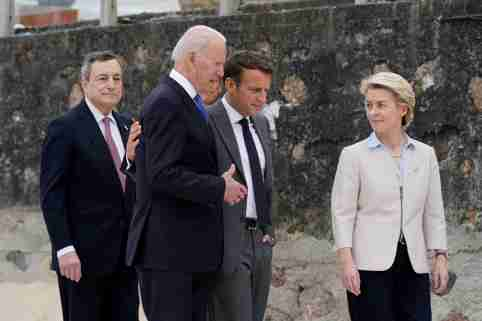 U.S. President Joe Biden walks with Italian Prime Minister Mario Draghi, France's President Emmanuel Macron and European Commission President Ursula von der Leyen after posing for the G-7 family photo with guests at the G-7 summit, in Carbis Bay, Cornwall, Britain June 11, 2021. Patrick Semansky/Pool via REUTERS