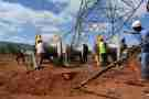 Nairobi, Kenya -June 13th 2017: Electric engineers laying down Electric transmission lines in rural Kenya, Africa. This lines transmit high power electricity to different regions countrywide.