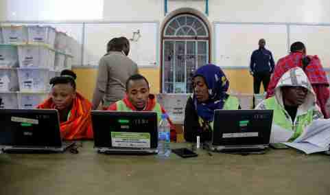 Election officials work at computers at a tallying center in Nairobi, Kenya.