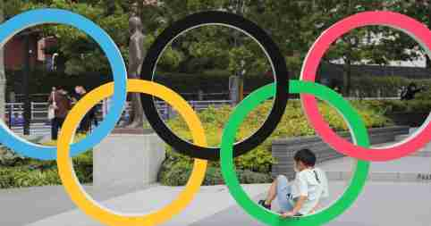 A photo shows a five-ring Olympic emblem in front of National Stadium in Shinjuku Ward, Tokyo on May 30, 2021.    ( The Yomiuri Shimbun )