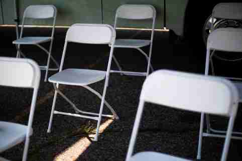 Empty chairs fill a waiting area for people after they receive their coronavirus disease (COVID-19) vaccines at a mobile pop-up vaccination clinic hosted by the Detroit Health Department with the Detroit Public Schools Community District at Renaissance High School in Detroit, Michigan, U.S., July 26, 2021. REUTERS/Emily Elconin