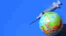A globe and syringe on a blue background