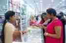 Women purchase jewelry at a shop counter in Bangladesh