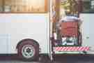 Person in a wheelchair getting on a bus.