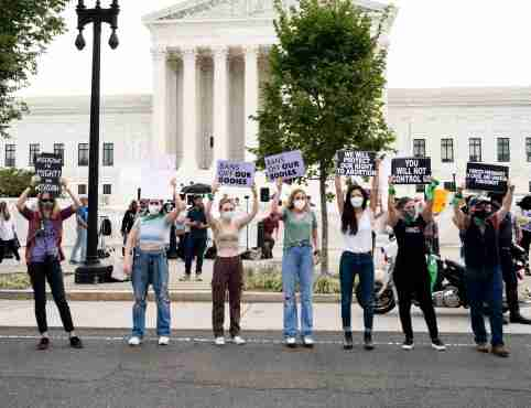 """October 4, 2021 - Washington, DC, United States: Protesters with signs saying """"Don't mess with us"""", """"We will protect our right to abortion"""", """"Bans off our bodies"""", and """"Forced pregagncy is cruel at a  protest with pro-life and pro-choice protesters in front of the Supreme Court. (Photo by Michael Brochstein/Sipa USA)No Use Germany."""