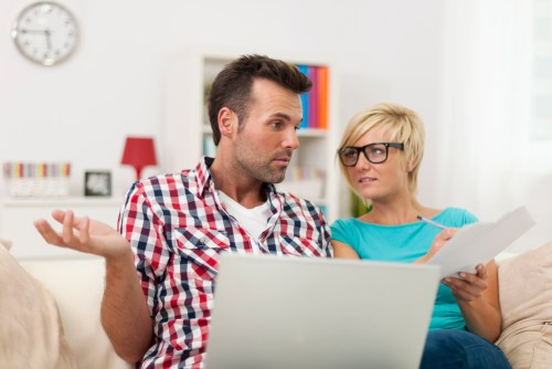 Confused couple learning about Brooklyn homeownership misunderstandings.