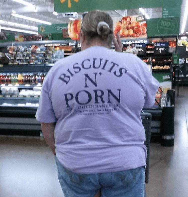 "Picture of an obese woman shopping at Wal-Mart, wearing a shirt that says, ""Biscuits N' Porn"""