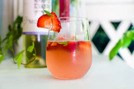 Sweet Sensations Summer Cocktail recipe. A perfect blend raspberry lemonade, CK Mondavi Moscato wine, strawberries and chocolate mint leaves.