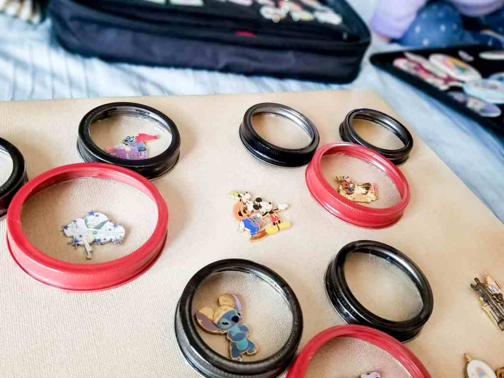 This DIY Disney Pin Board is easy to make and fun to display. Using Mason jar lids to create everyone's favorite Mickey Mouse to help frame, Disney Pins.