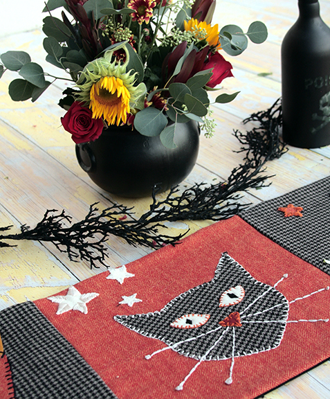 Sugar and Spice Halloween Table Runner and flowers