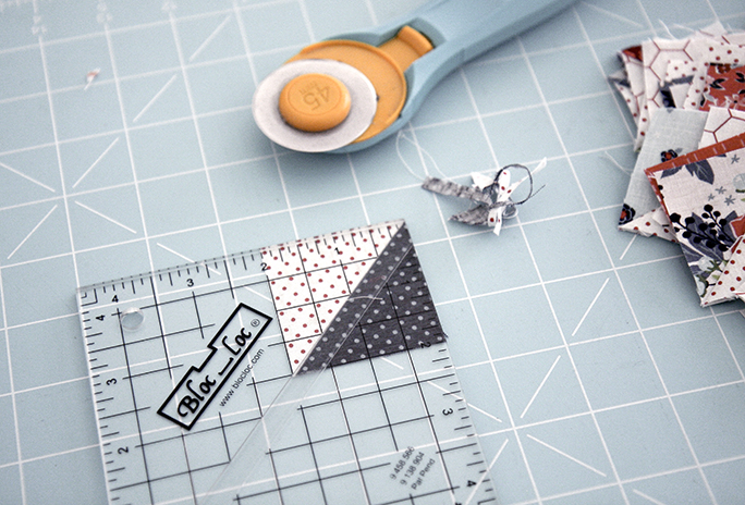 One of my favorite rulers is this Bloc Loc that help you make the perfect Half Square Triangle.