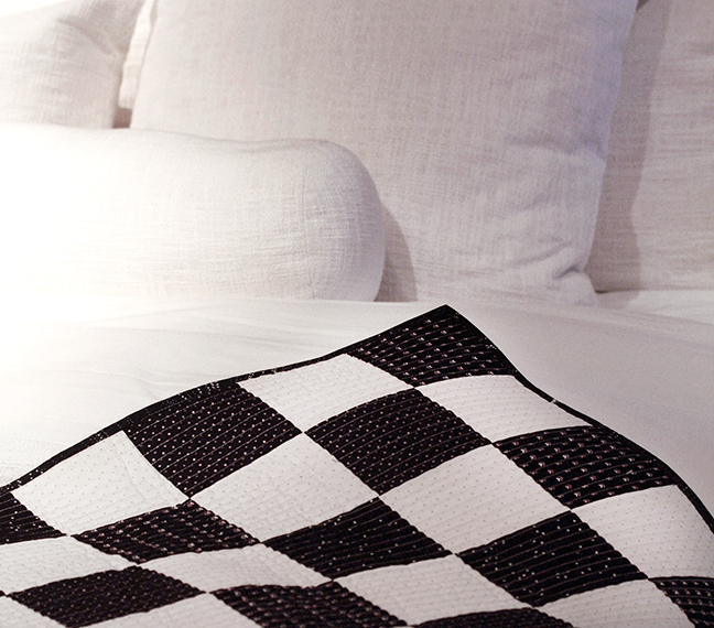 Chess Board Quilt on bed