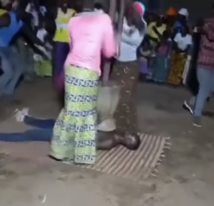 Shocking moment as 2 women pound fufu on the chest of a man (Video)