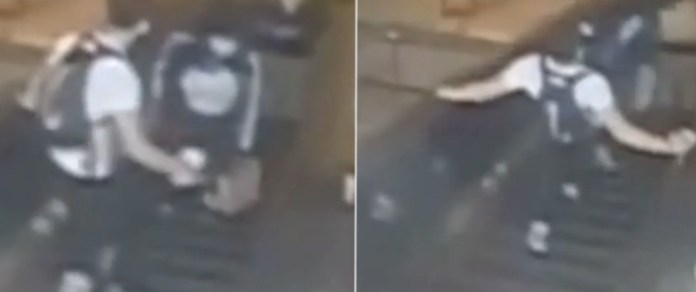 Viral video captures the moment man kicked a woman down an escalator