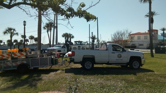 Public Works trucks arrive to begin work on Brownie the Town Dog Memorial.