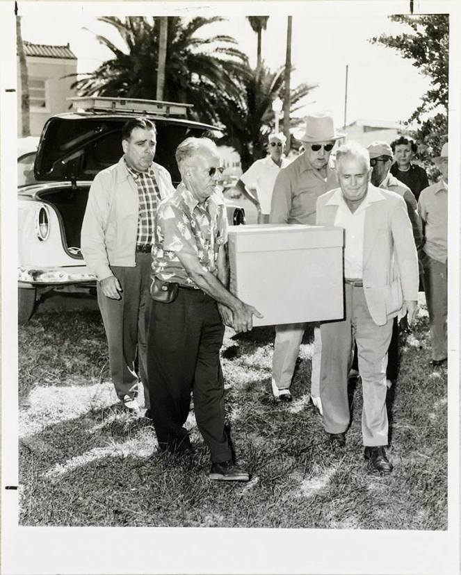 Brownie is carried from a cab to his final resting place. The pallbearers listed on the back are, from left, Ed Budgen (owner of Daytona Cab Co.), Harry Moore, C.P. Miller, and Herb Budgen.