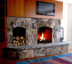 "Mosaic Fieldstone, ""Dry Look"", Raised Caledonia Granite Hearth, Arched Firebox Opening, Woodbox"