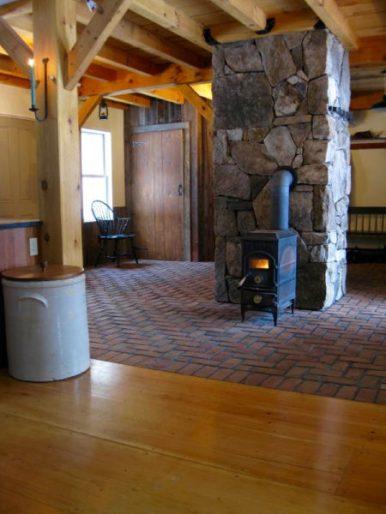 Weathered Granite Chimney & Herringbone Brick Floor