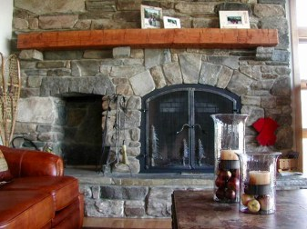 Mixed Ashlar & Veneer, Arched Opening, Woodbox, Beam Mantel w/ Stone Supports, Raised Flagstone Hearth