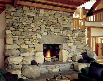Boulder Fireplace w/stone seats