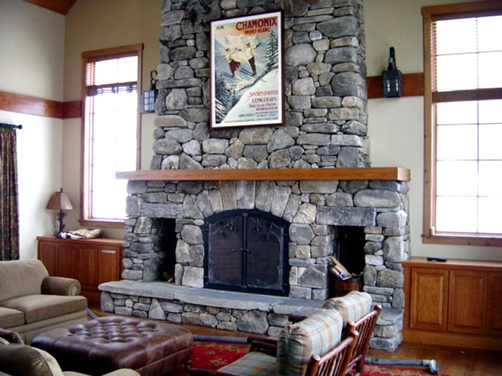 Round Fieldstone, Arched Fireplace Opening, 2 Woodboxes, Raised Flagstone Hearth, Wood Mantel