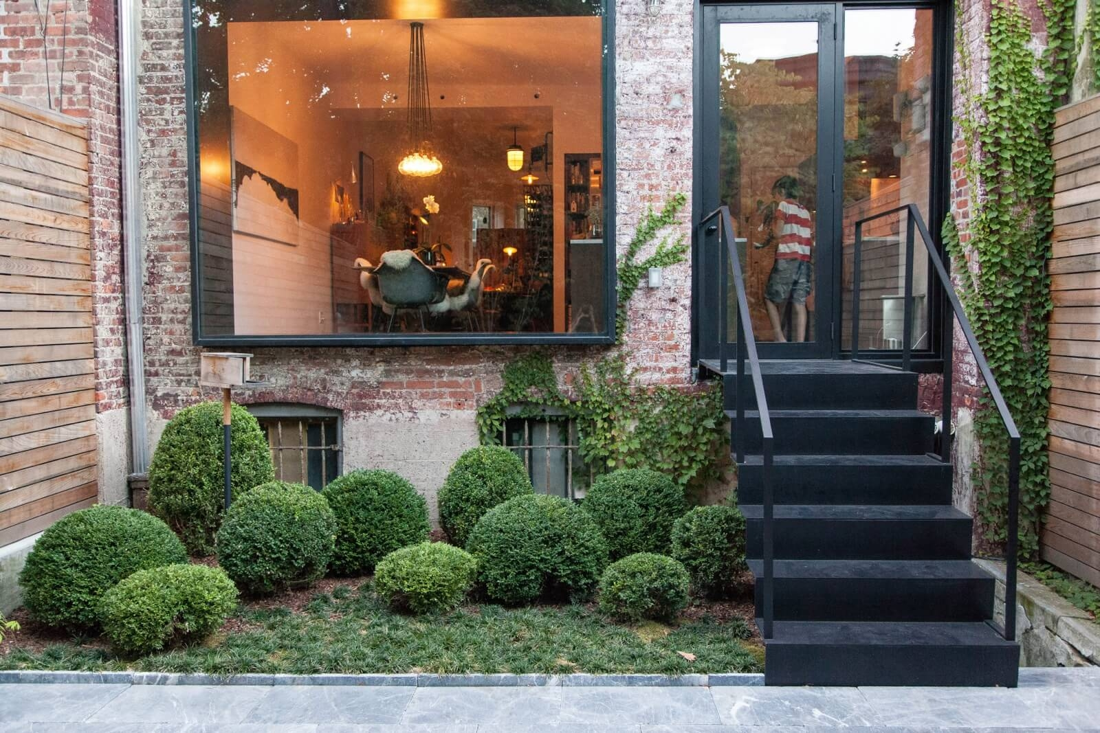 Garden Design Ideas A Stylish Low Maintenance Brooklyn Garden | Under Stair Garden Design | Plant | Ideas | House | Stair Case | Pebble Garden