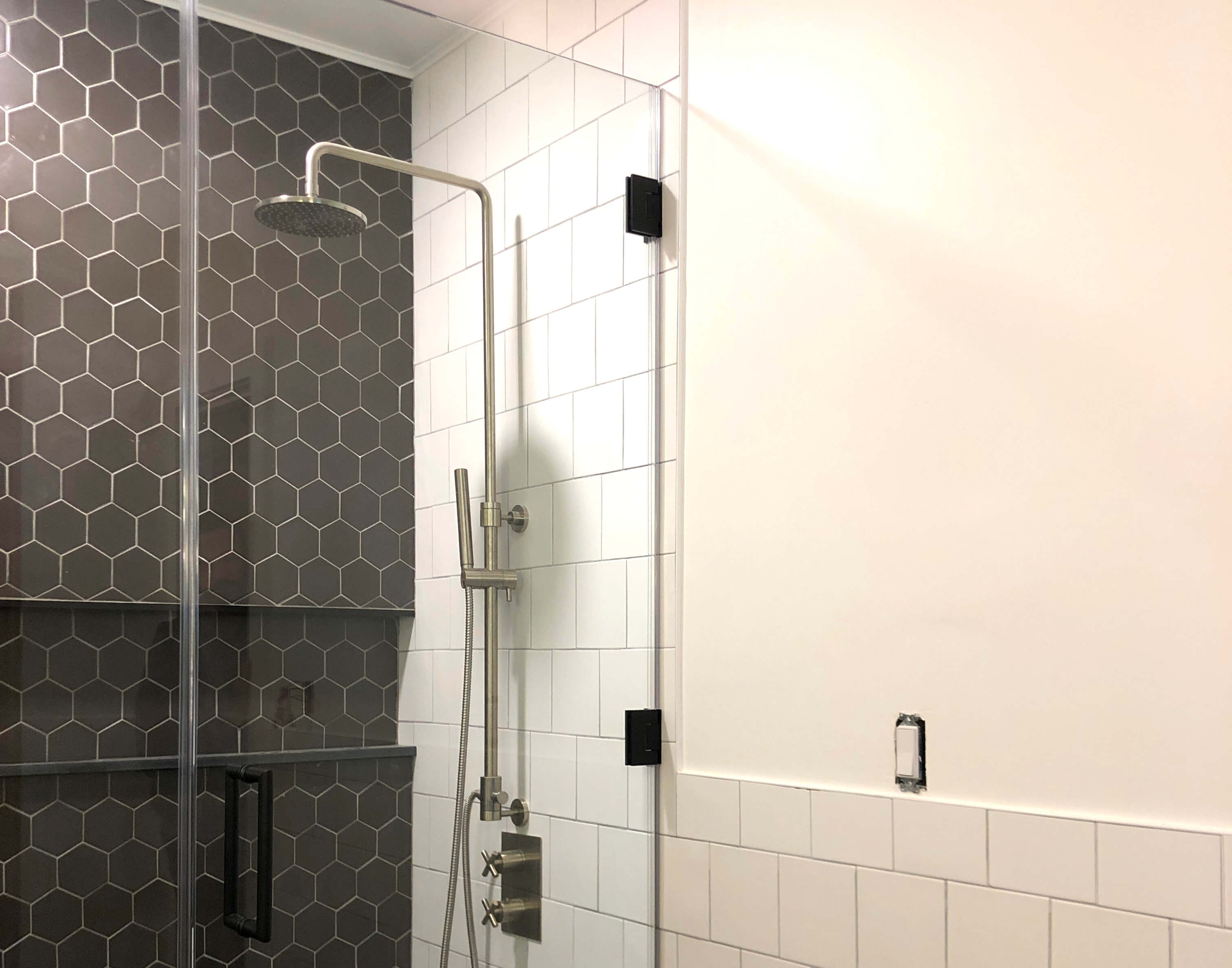 glassy with shower and tub enclosures