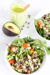 Greens, quinoa and black beans salad with creamy and healthy cilantro mint dressing