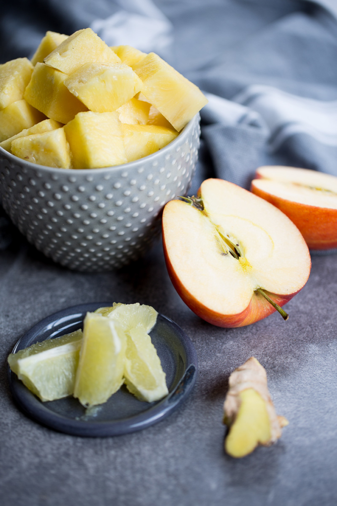 pineapple chuncks, halved apple, ginger and lemon