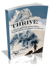 A 3-D photo of the ebook Thrive! Creating what matters most, by Bruce Elkin. It is standing on a white surface, throwing a shadow. The back ground the bluish cover is a photo of a mountain with a man looking up at it from a foreground ridge