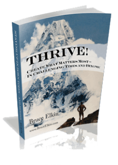 Cover photo of Thrive! Creating what matters most, by Bruce Elkin. A man stands on a foreground ridge,  hand on hips, looking up at Mount Ama Dablam in the Himalayas.