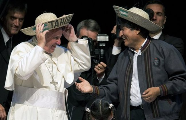 Mr Pope with extreme lefty wearing badge of mass murderer.