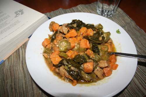Caribbean Chicken Pepper pot stew in a white bowl.