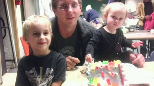 brummer family and gingerbread house