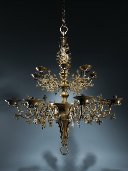 A magnificent sixteen-light bronze chandelier surmounted by the Virgin of the Immaculate Conception | Southern Netherlands | c. 1480 - 1520 | cast brass/latten