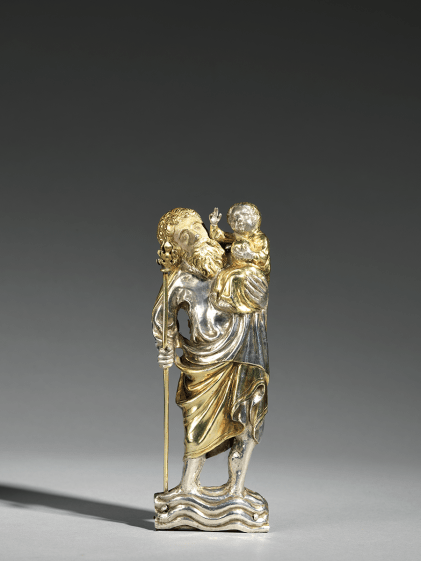 A parcel-gilt and painted figure of St Christopher | Germany, Westphalia or Lower Saxony | Early 15th century | ; repoussé silver and silver gilt with later pigment layers