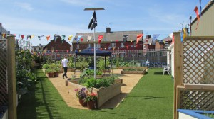 Picture of the garden at Brunswick Youth and Community Centre with bunting and greenery.