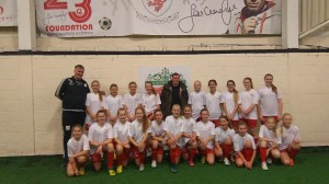 Jamie Carragher with girls football team visiting from Norway.